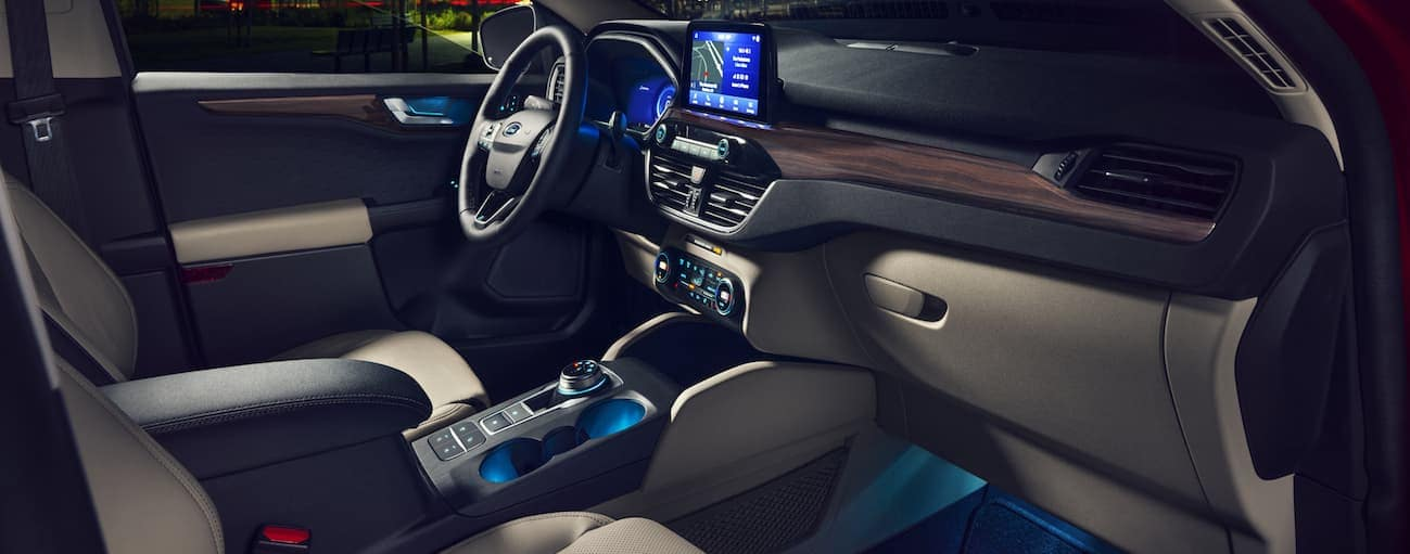 The front interior of a 2020 Ford Escape with an infotainment system is shown.