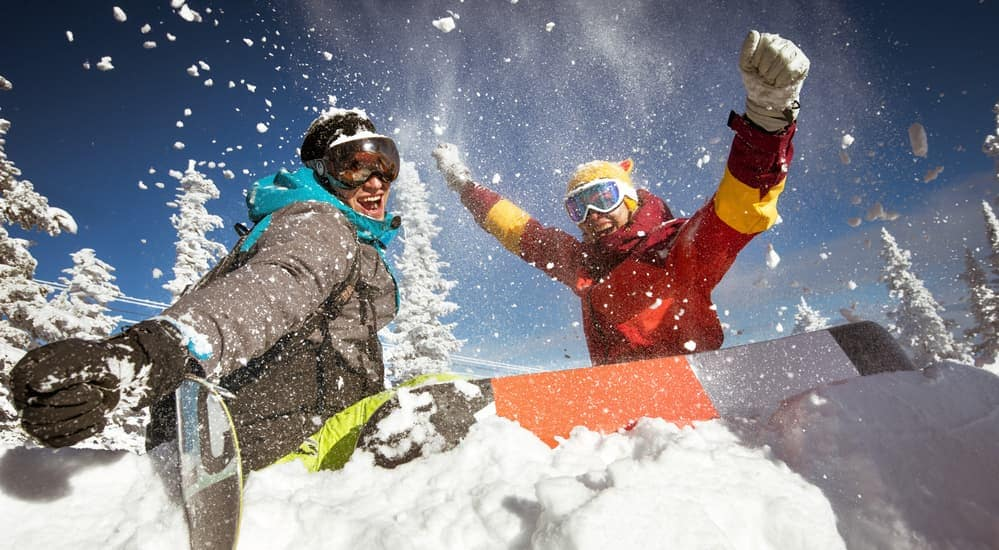 Two friends are enjoying snowboarding on a mountain near Albany, NY.