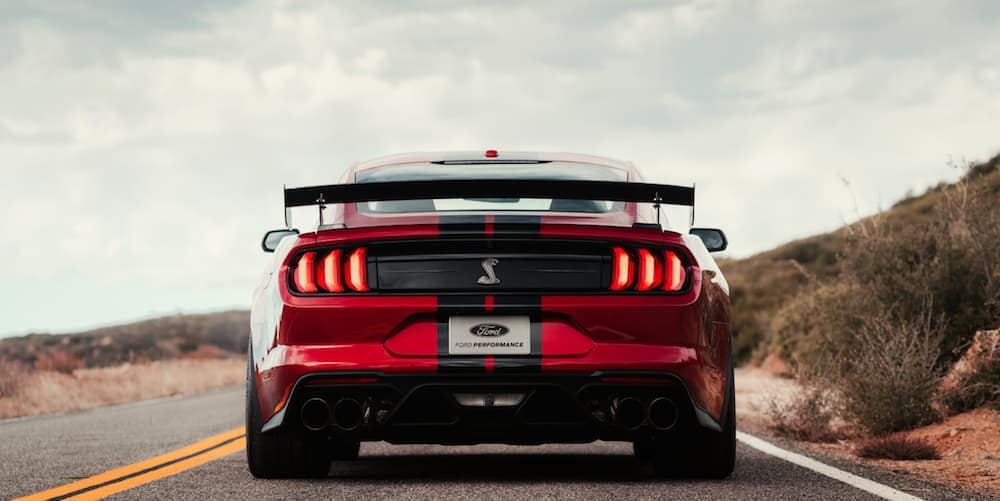 A red 2020 Ford Mustang GT500 is shown from behind parked on a road after leaving a local Ford dealership in Albany, NY.