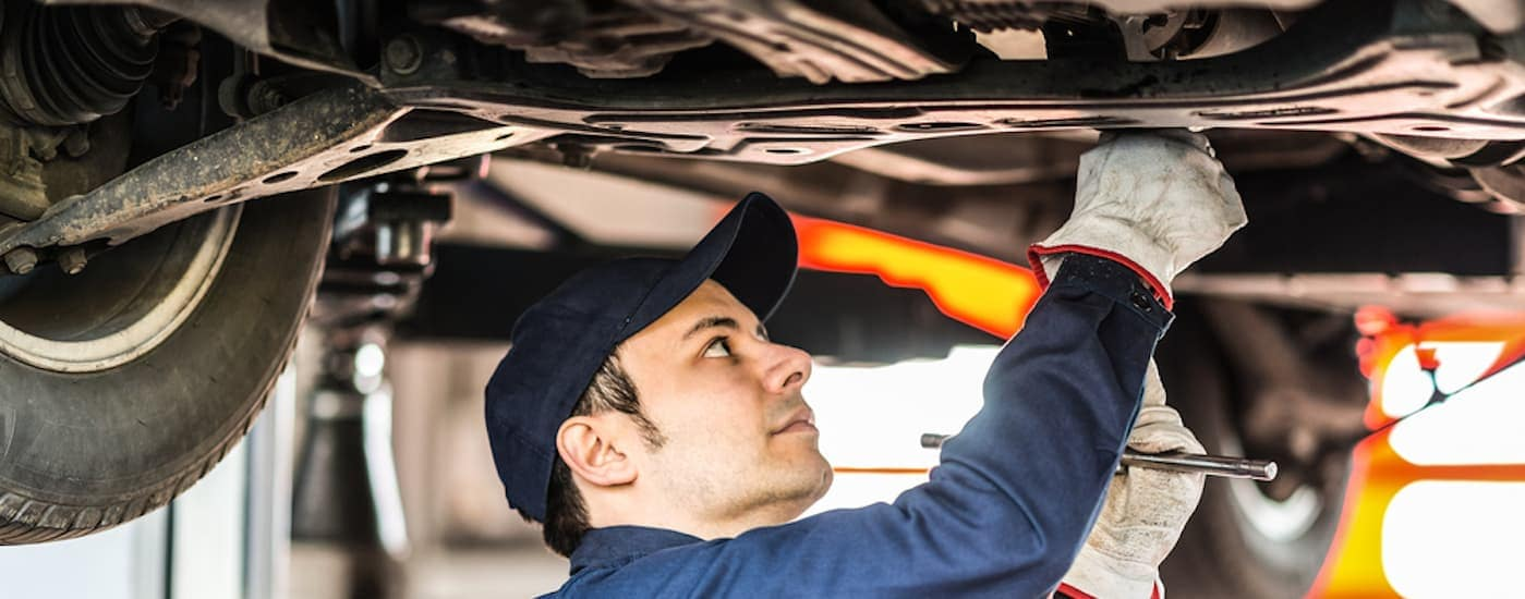 A trusted mechanic is working on a customer's car at an Albany, NY dealership.