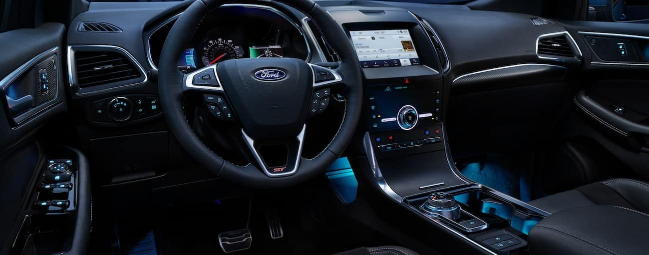 The front black leather interior of a 2020 Ford Edge ST is shown.