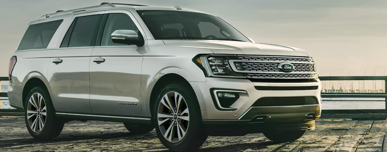 A silver 2020 Ford Expedition is parked on a beach pier during dusk.