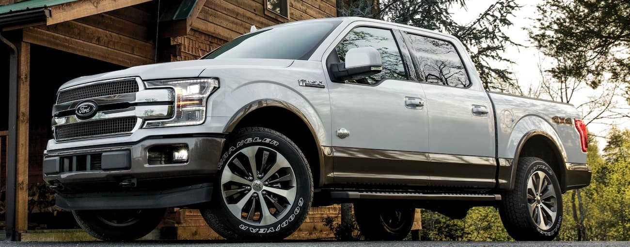 A white 2020 Ford F-150 is parked in a driveway.
