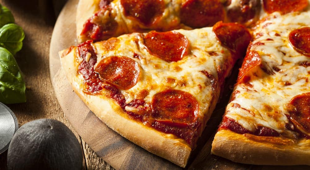 A close up of slices of pepperoni pizza is shown,