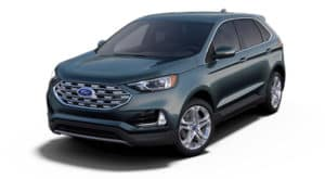 A green 2019 Ford Edge is facing left.