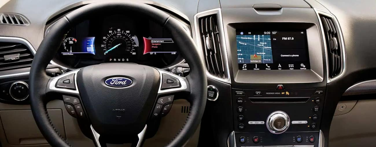 The technology features on the dashboard of the 2019 Ford Edge are shown.
