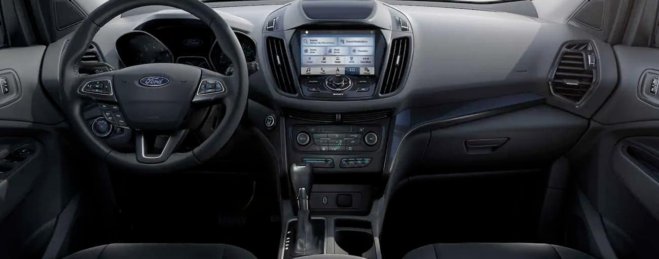 The black dashboard and infotainment screen are shown in a 2019 Ford Escape.
