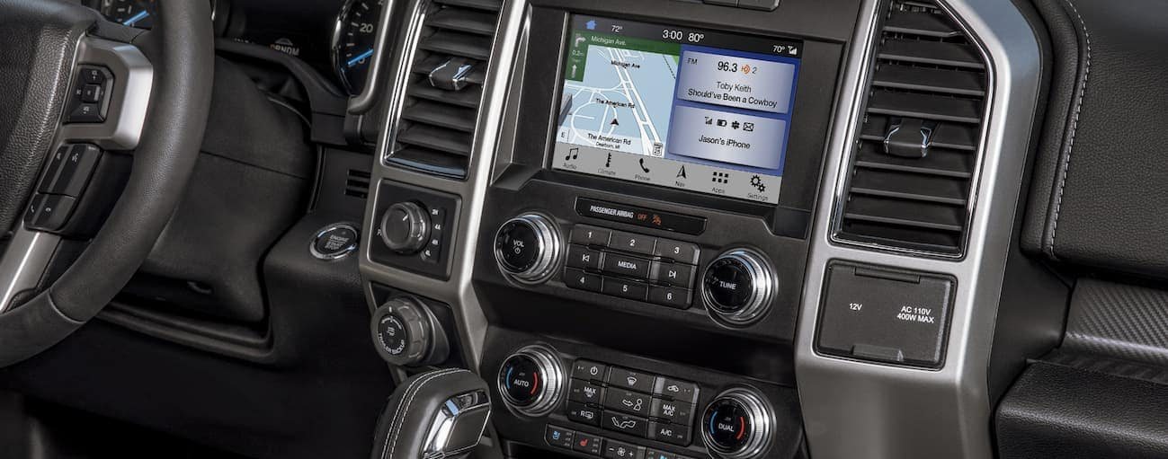 A close up of the infotainment system and temperature controls that are found in the 2020 Ford F-150 are shown.