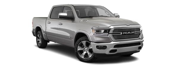 A silver 2020 Ram 1500 is facing right.
