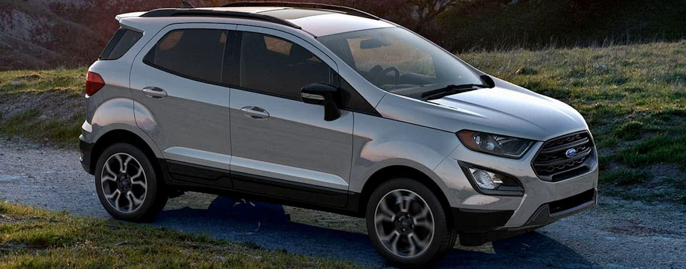 A silver 2020 Ford Ecosport is driving on a narrow road after leaving a Ford dealership near me.