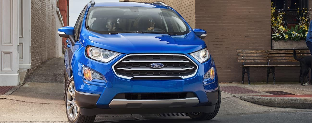 A blue 2020 Ford Ecosport is turning out of an alley near Albany, NY.