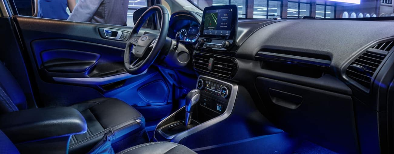The interior of a 2020 Ford Ecosport is shown with blue lighting.