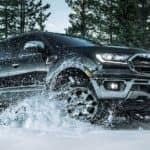 A black 2020 Ford Ranger is driving through the snow near Albany, NY.
