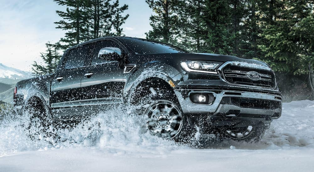A black 2020 Ford Ranger, which is a popular option among the 2020 Ford trucks, is driving through the snow near Albany, NY.