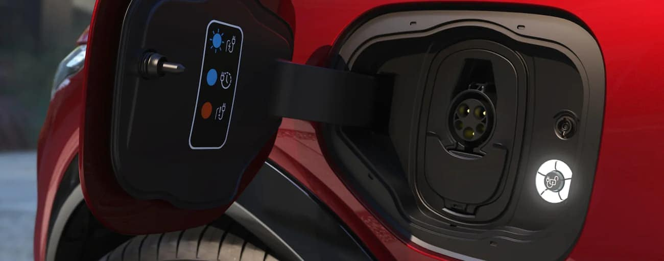 A close up of the charging port on the Mach-E is shown.