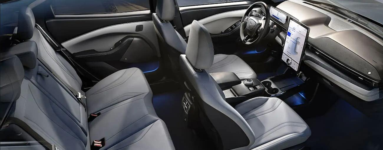 A birds eye view of the light grey leather interior of a 2021 Ford Mustang Mach-E is shown.