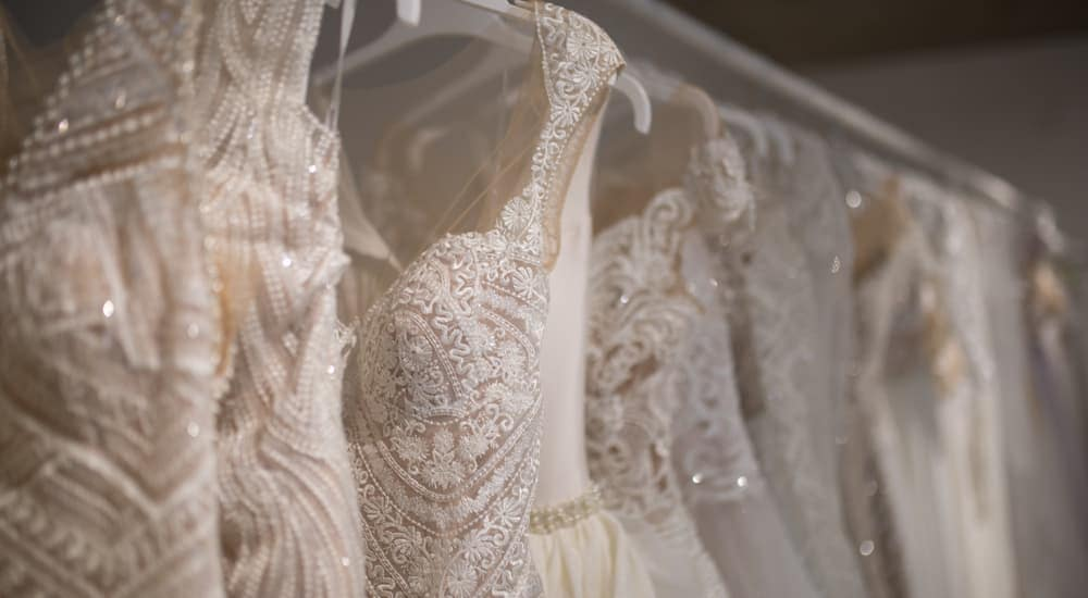 A row of wedding dresses is shown.