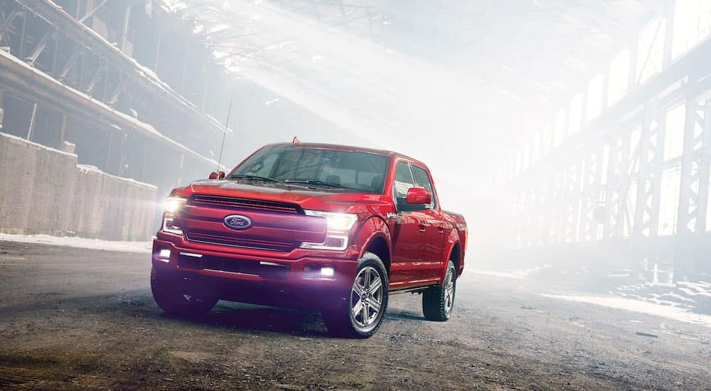 A red 2018 Ford F-150 is in a dusty warehouse in Albany, NY.