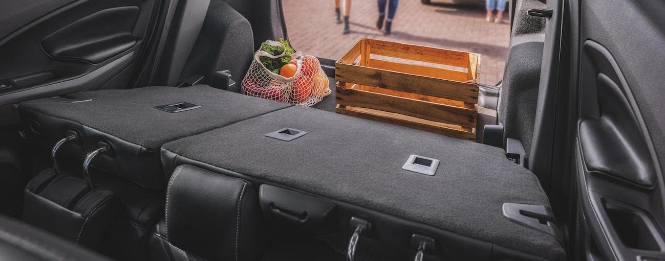The rear seats are folded down with cargo in the rear of a 2020 Ford EcoSport.