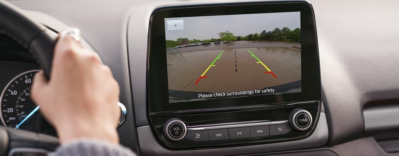 The backup camera of a 2020 EcoSport is being used on the infotainment screen.