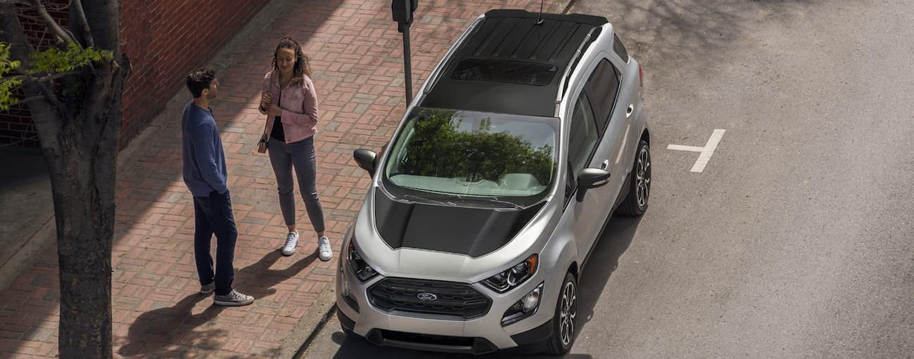 A birds eye view of a silver and black 2020 Ford EcoSport, which wins when comparing the 2020 Ford EcoSport vs 2020 Nissan Kicks, is parked on the side of a street near Albany, NY.