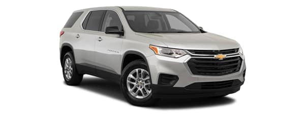 A silver 2020 Chevy Traverse is facing right.
