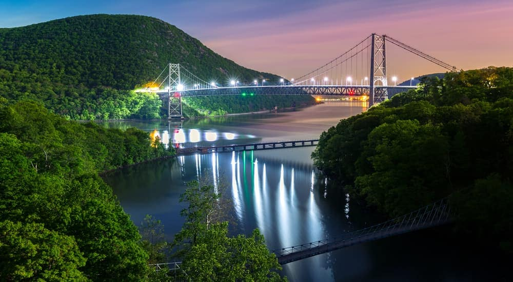 The Bear Mountain bridge near Hyde Park in NY is lit up at night.