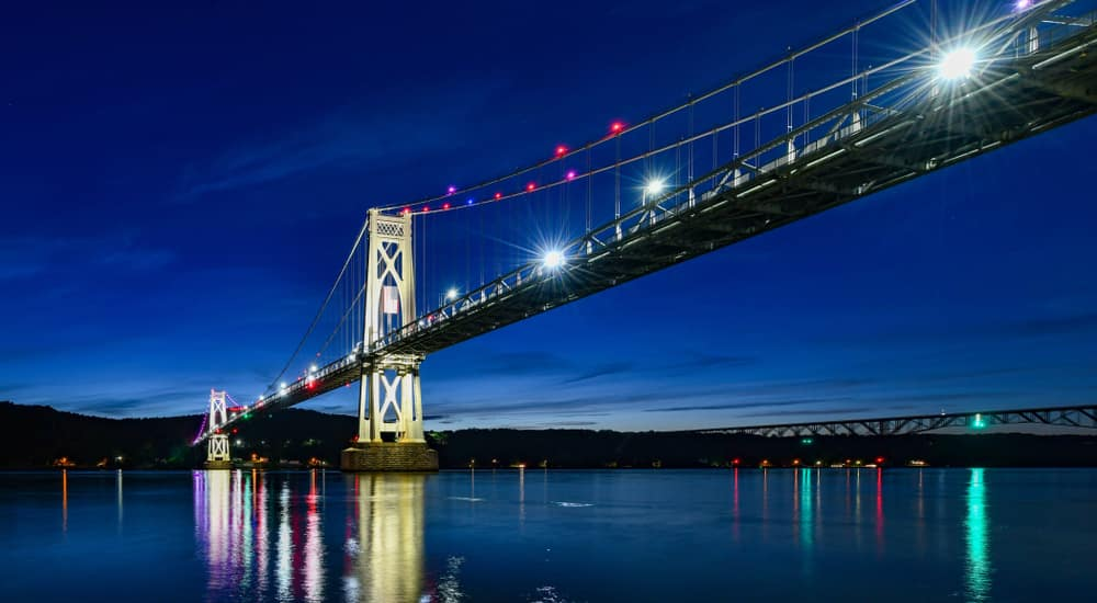 Mid Hudson Bridge lit up across the Hudson river near Poughkeepsie, NY