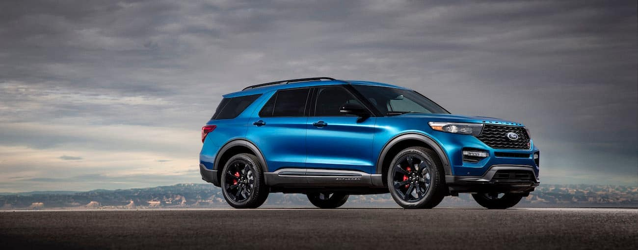 A blue 2020 Ford Explorer ST is shown at dusk.