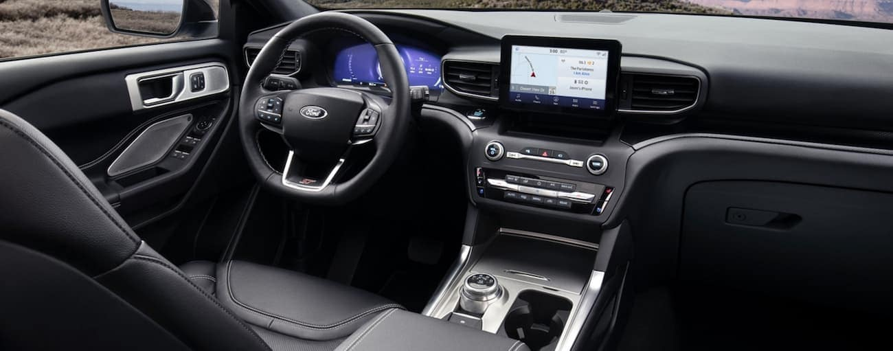 The black interior of a 2020 Ford Explorer is shown.