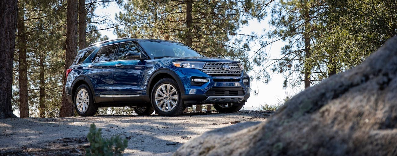 A blue 2020 Ford Explorer is parked on a hill in the woods outside Albany, NY.