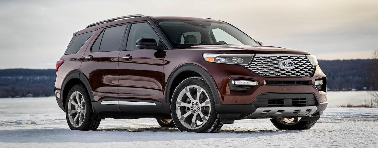 A maroon 2020 Ford Explorer is parked in a snowy field outside Albany, NY.