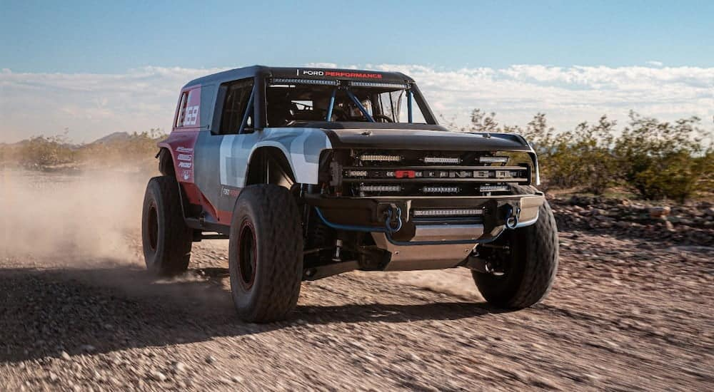 A Race Prototype of the 2021 Ford Bronco, soon to be popular among Ford SUVs, is driving in the desert.
