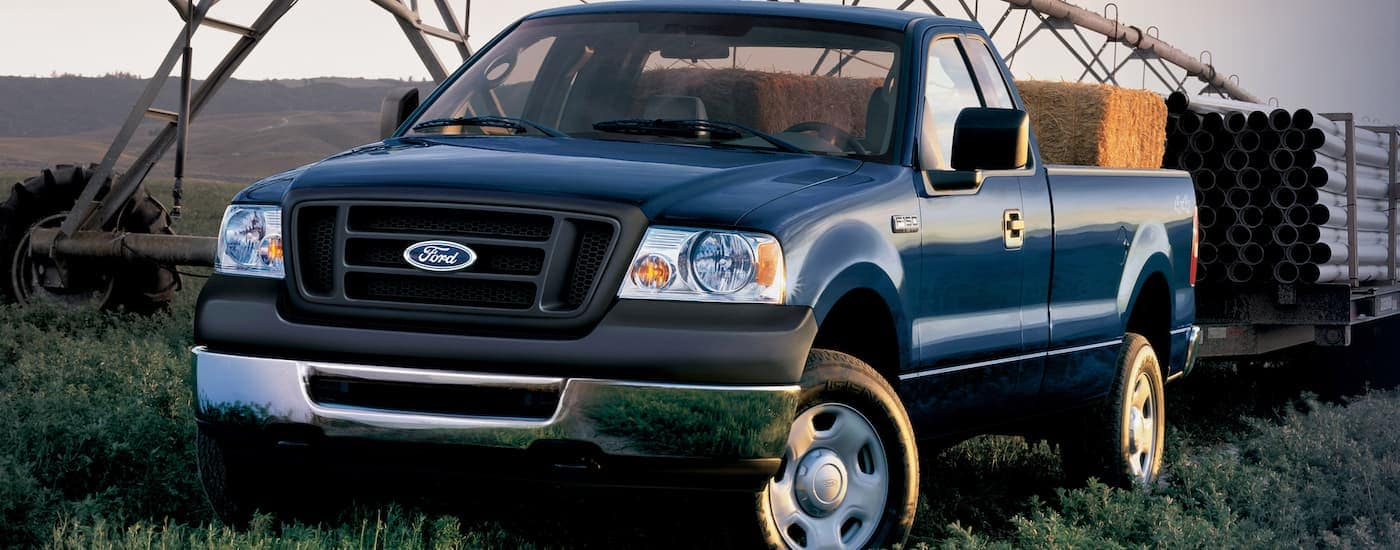 A blue 2006 Ford F-150, which is popular among used Ford trucks, is parked on a farm near Albany, NY.