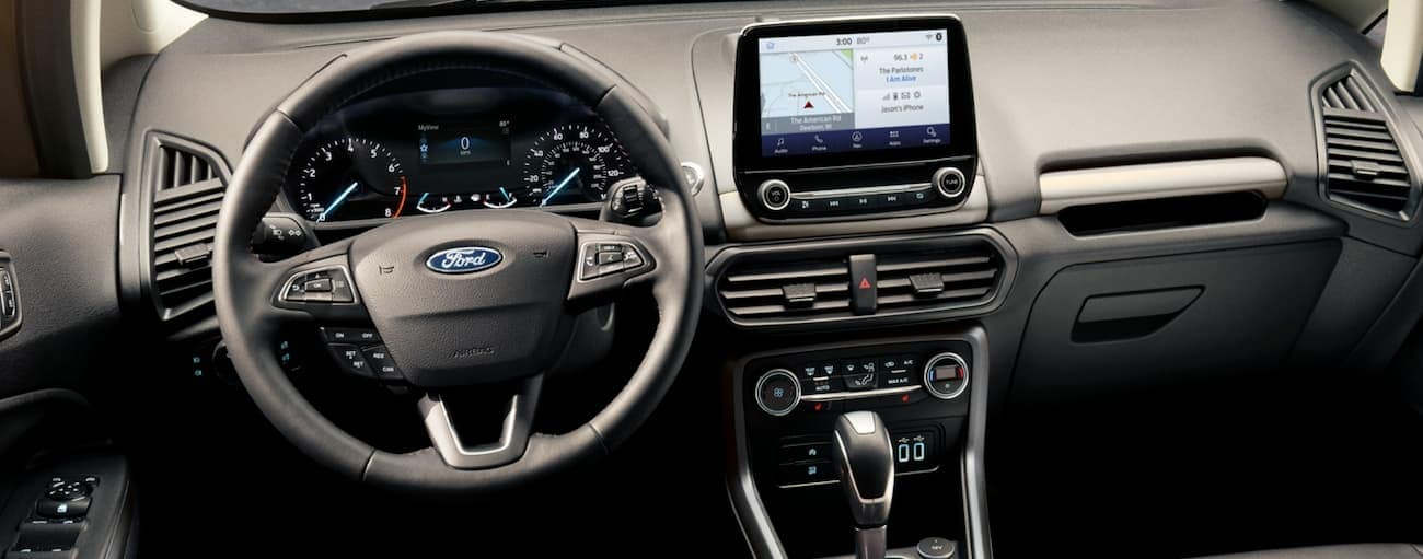 The dashboard and touchscreen in a 2020 Ford EcoSport are shown.