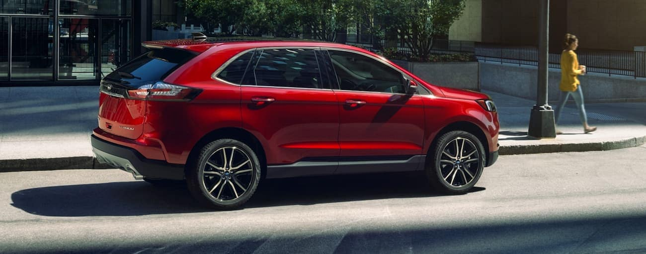 A red 2020 Ford Edge is parked on a city street near Albany, NY.