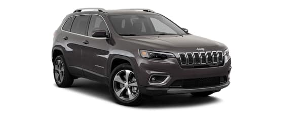 A dark grey 2020 Jeep Cherokee is angled right.