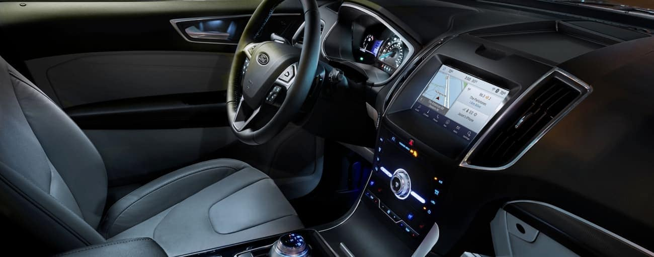 The interior of the 2020 Ford Edge is shown with ambient lighting.