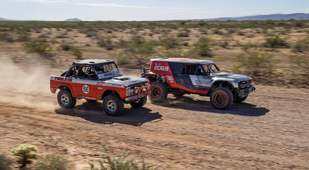 A 1969 Baja 1000 Bronco is racing the 2021 Ford Bronco prototype in the desert.