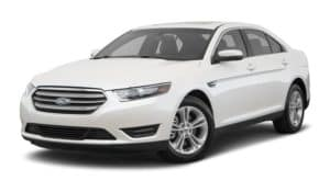 A white 2017 Ford Taurus is facing left.