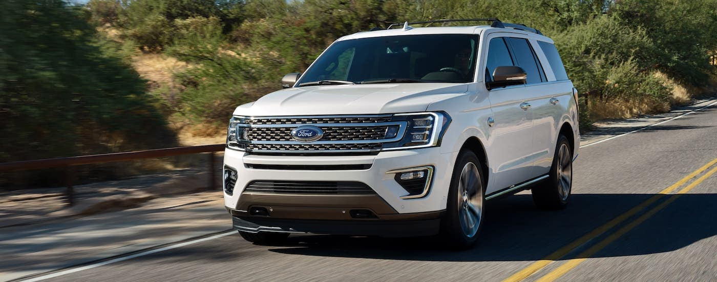 A white 2020 Ford Expedition King Ranch is driving on a highway near Albany, NY.