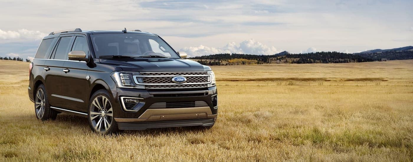 A black 2020 Ford Expedition is parked in a field after winning the 2020 Ford Expedition vs 2020 Chevy Tahoe comparison.