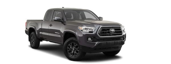A grey 2020 Toyota Tacoma is facing right.
