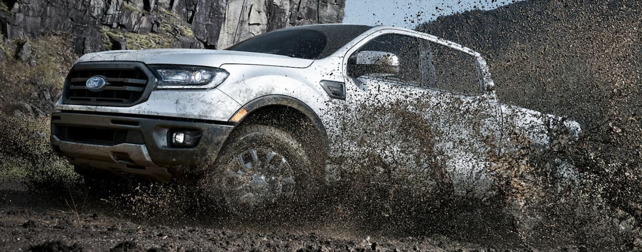 A white 2020 Ford Ranger is off-roading in the mud outside of Albany, NY.