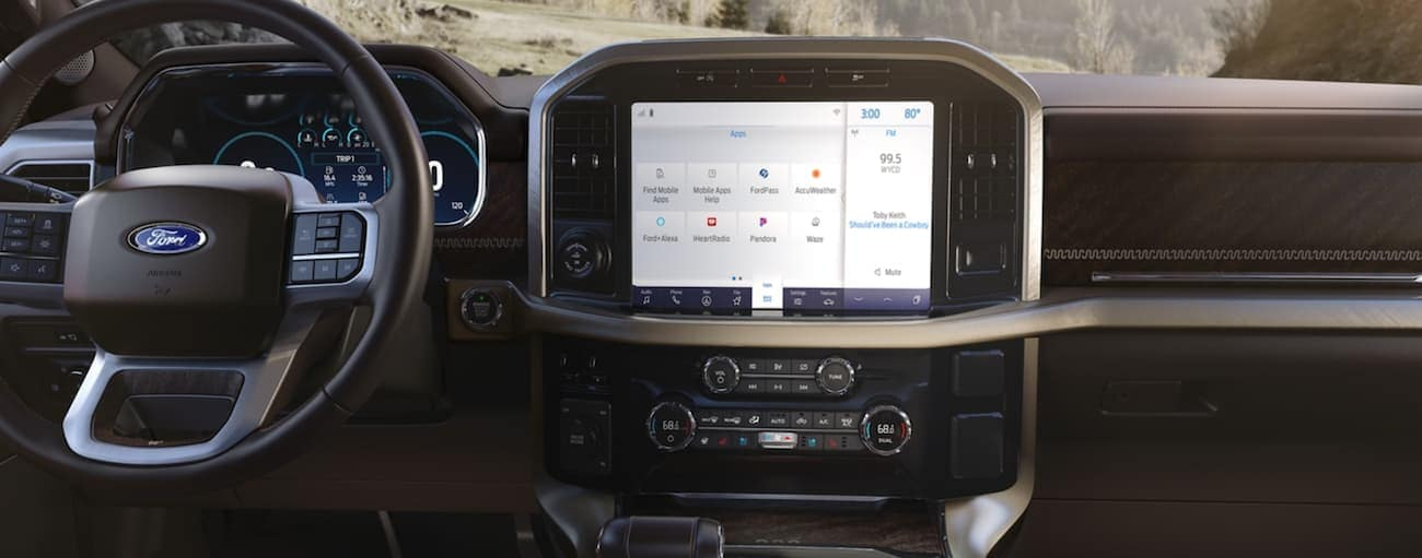 The infotainment screen is shown in a 2021 Ford F-150.