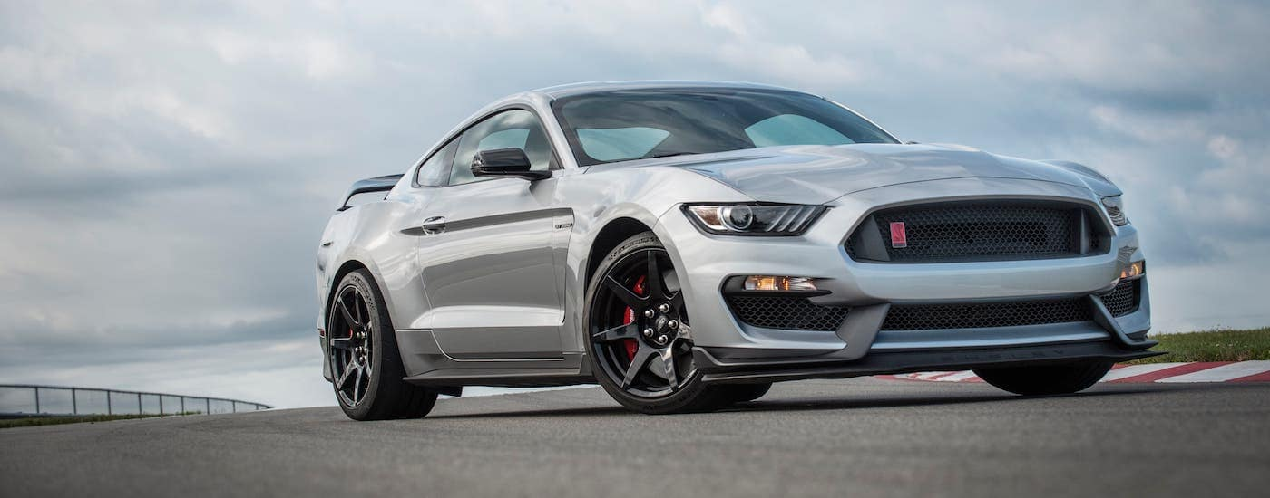 A silver 2020 Ford Mustang GT350R is parked on an empty race track.