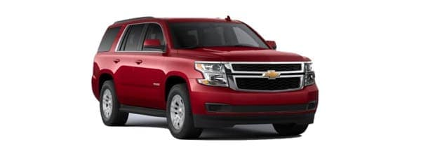 A red 2020 Chevy Tahoe is angled right.
