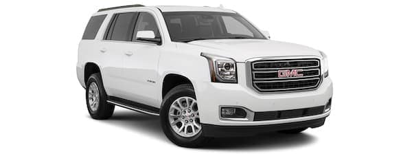 A white 2020 GMC Yukon is angled right.