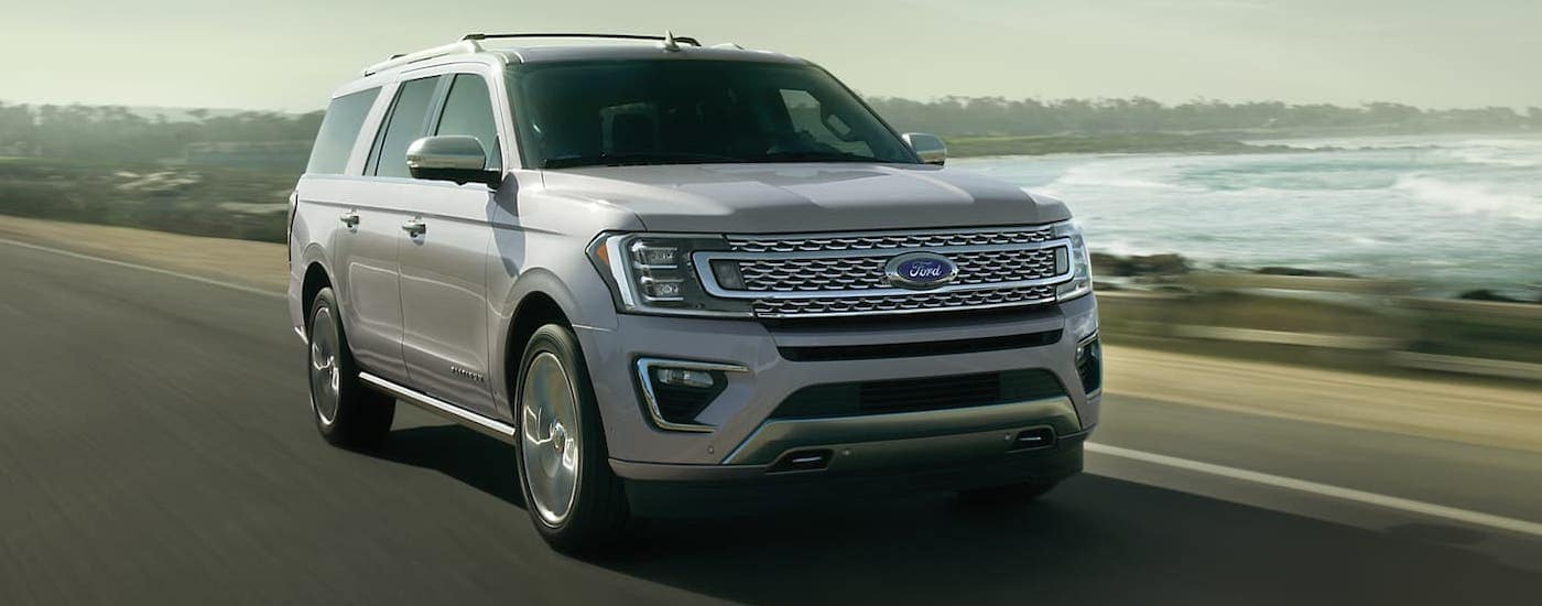 A white 2020 Ford Expedition is driving along the coast after winning the 2020 Ford Expedition vs 2020 Nissan Armada comparison.