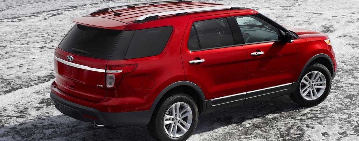 A red 2012 Ford Explorer is parked on salt flats.